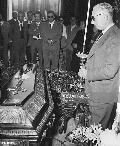 Italian race car driver and businessman Enzo Ferrari attends the funeral of Spanish racing driver Alfonso de Portago 14th May 1957 De Portago was...
