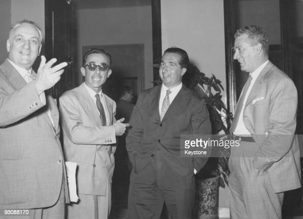 Italian race car driver and businessman Enzo Ferrari meets up with champion racing driver Alberto Ascari at a hotel in Salsomaggiore Terme, Italy,...