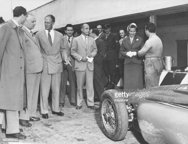 Italian race car driver and businessman Enzo Ferrari shows the former King Leopold and Princess Lilian of Belgium the latest model of the Ferrari...