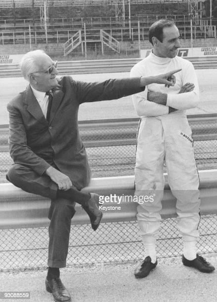 Italian race car driver and businessman Enzo Ferrari with racing driver Tino Brambilla during trials for the 10th Gran Premio della Lotteria di Monza...