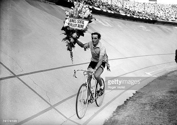 Italian racing cyclist Fausto Coppi making his lap of honour at the Parc des Princes Paris after winning the 1952 Tour de France