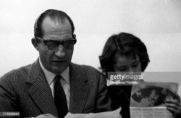 Italian racing cyclist Gino Bartali and his daughter Bianca Maria Bartali reading some papers. Florence, 1960s.