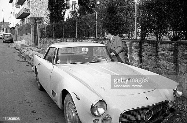 Italian racing cyclist Gino Bartali closing the car door Florence 1960s