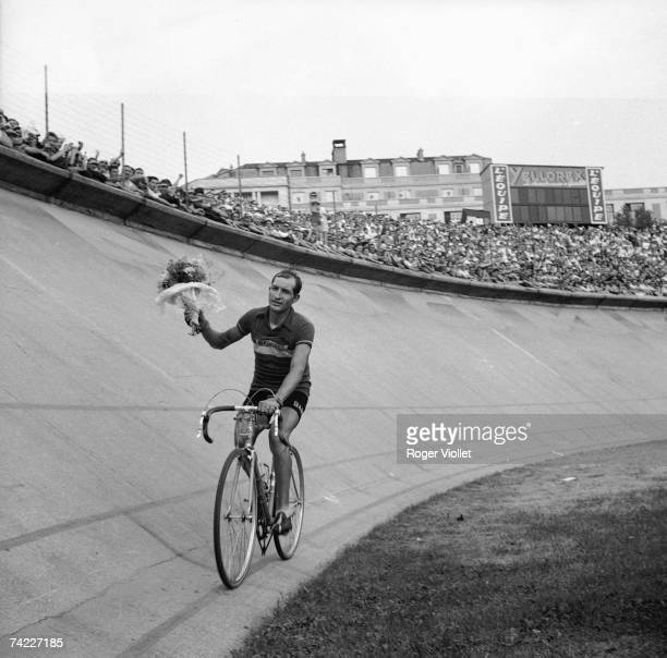 Italian racing cyclist Gino Bartali cycling round the velodrome at the Parc des Princes after winning the 1938 Tour de France 31st July 1938
