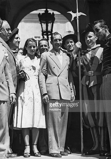 Italian racing cyclist Gino Bartali with his wife Adriana at the Vatican for an audience with Pope Pius XII after Bartali won the Tour De France 10th...