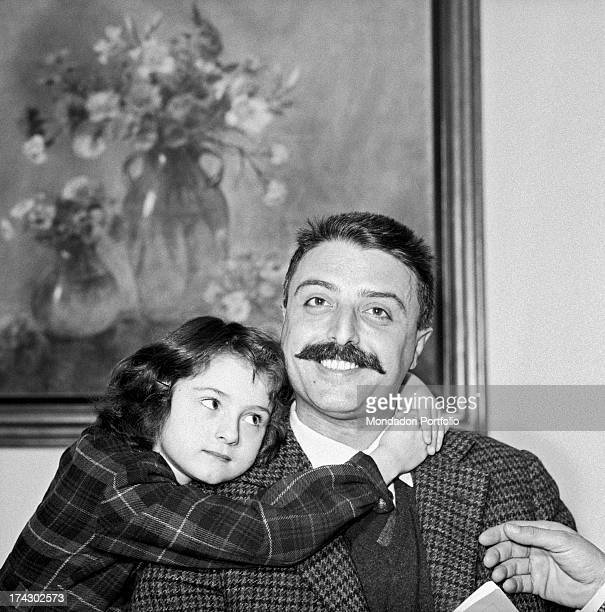 Italian racing cyclist Gino Bartali's daughter Bianca Maria Balti hugging Italian journalist Giorgio Torelli. Florence, 1960s.