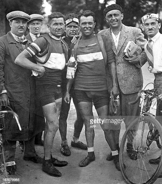 Italian racing cyclist Learco Guerra jellow jersey and winner of the 2nd stage CaenDinan of the 24th Tour de France poses with Alfredo Binda on July...