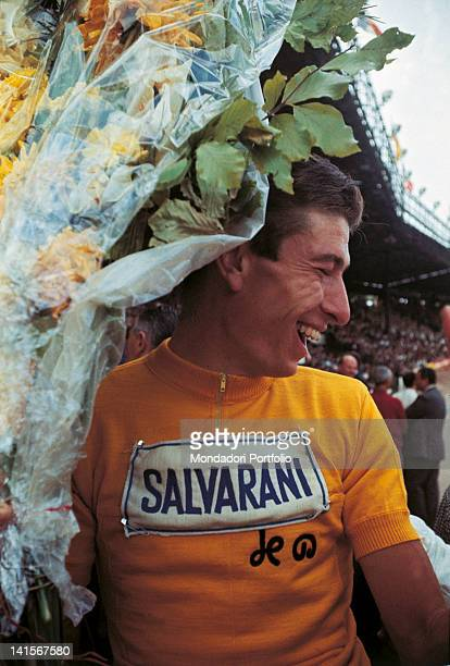 Italian racing cyclist of the Salvarani team and 52th Tour de France leading athlete Felice Gimondi wearing the yellow jersey at the Parc des Princes...
