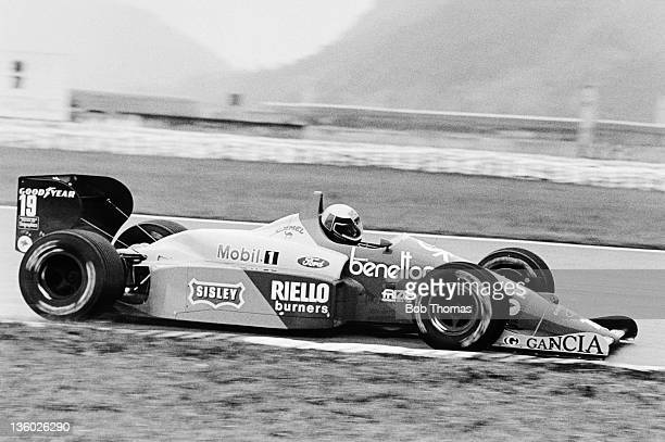 Italian racing driver Alessandro Nannini drives the Benetton Formula Ltd Benetton B188 Cosworth V8 in the 1988 Brazilian Grand Prix in Rio de Janeiro...
