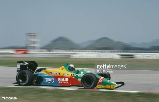 Italian racing driver Alessandro Nannini drives the Benetton Formula Ltd Benetton B188 Ford DFR V8 in the 1988 Brazilian Grand Prix at Autodromo...