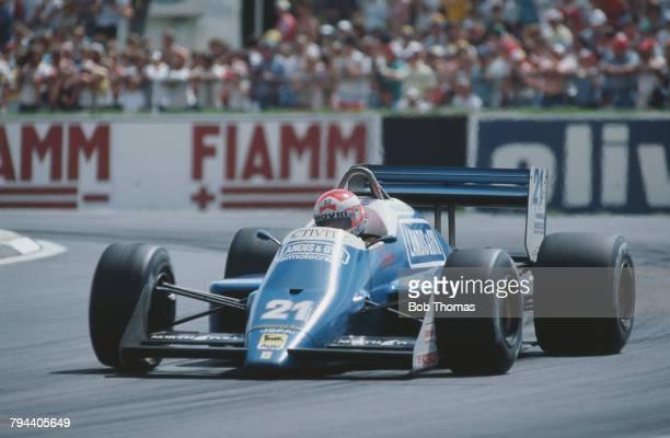 Italian racing driver Alex Caffi drives the Osella Squadra Corse Osella FA11 Alfa Romeo V8 in the 1987 British Grand Prix at Silverstone circuit in...