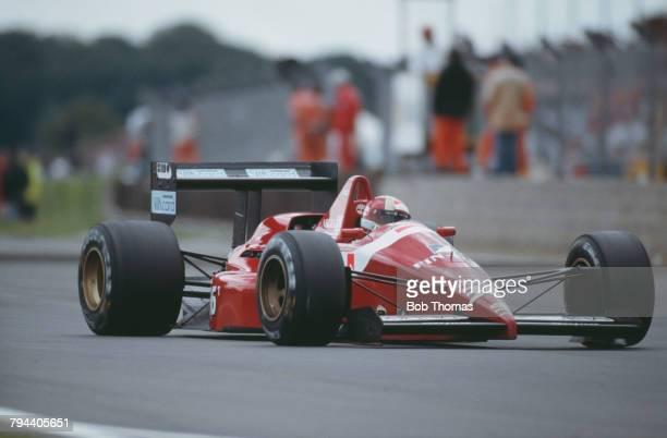 Italian racing driver Alex Caffi drives the Scuderia Italia Dallara 188 Cosworth V8 to finish in 11th place in the 1988 British Grand Prix at...