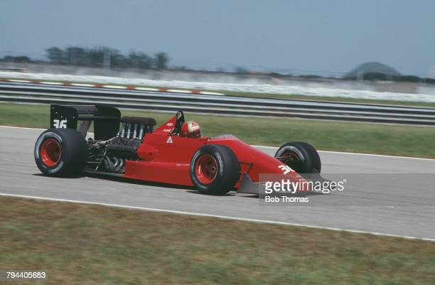 Italian racing driver Alex Caffi drives the Scuderia Italia Dallara 3087 Cosworth V8 during qualification for the 1988 Brazilian Grand Prix at...