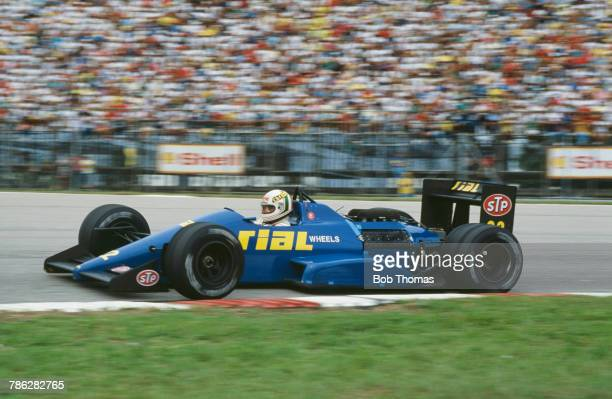 Italian racing driver Andrea de Cesaris drives the Rial Racing Rial ARC1 Ford Cosworth DFZ 35 V8 in the 1988 Brazilian Grand Prix at the Autodromo...
