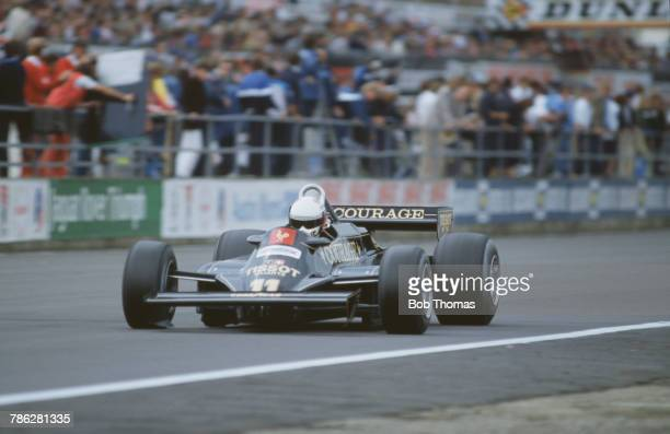 Italian racing driver Elio de Angelis drives the John Player Team Lotus Lotus 87 Cosworth V8 in the 1981 British Grand Prix at Silverstone Circuit in...
