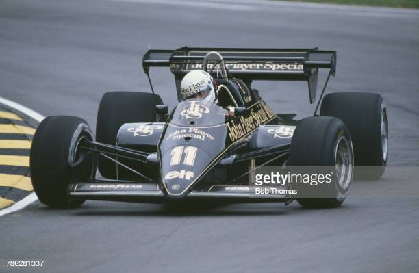 Italian racing driver Elio de Angelis drives the John Player Team Lotus Lotus 95T Renault V6 to finish in 4th place in the 1984 British Grand Prix at...
