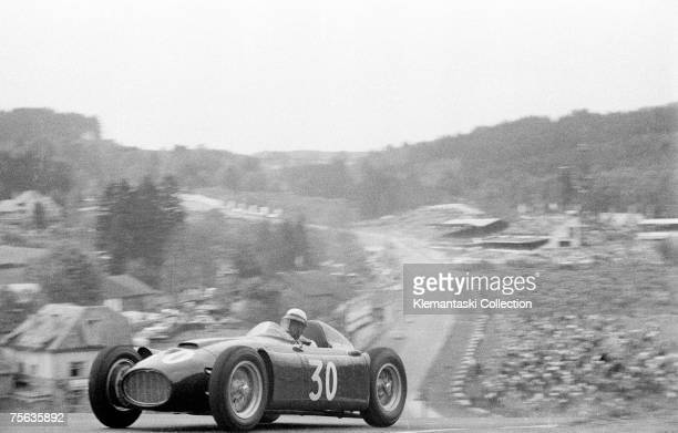 Italian racing driver Eugenio Castellotti comes over the top of Radillon after Eau Rouge in the Lancia D50 during the Belgian Grand Prix at Spa...