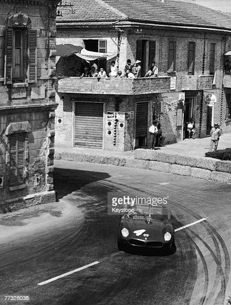 Italian racing driver Lorenzo Bandini driving a Ferrari 250 Testa Rossa to victory in the Pescara Four Hours in Pescara Italy 15th August 1961...