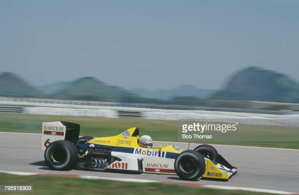 Italian racing driver Riccardo Patrese drives the Canon Williams Team Williams FW12 Judd CV 35 V8 in the 1988 Brazilian Grand Prix at Autodromo...