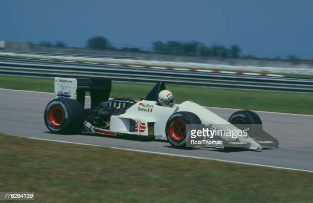 Italian racing driver Stefano Modena drives the EuroBrun Racing EuroBrun ER188 Cosworth V8 in the 1988 Brazilian Grand Prix at the Autodromo...