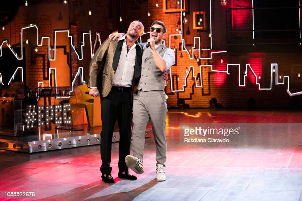 Italian Rapper Gue Pequeno and Alessandro Cattelan sing 'Broccoletti' during 'E Poi C'e' Cattelan' tv show at Teatro Parenti on October 30 2018 in...