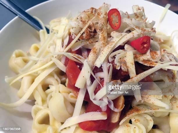 italian ravioli dish served in plate with parmesan cheese - rafael ben ari stock-fotos und bilder