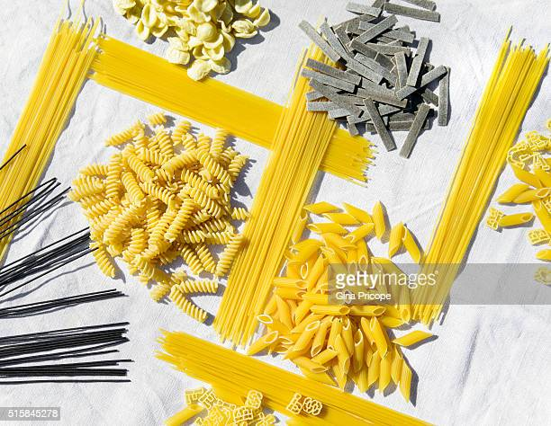 Italian raw pasta in smal groups on a kitchen towel.