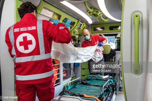 Italian Red Cross members check and prepare the ambulance before their shift on April 4, 2020 in Bergamo, Italy. The number of new COVID-19 cases...