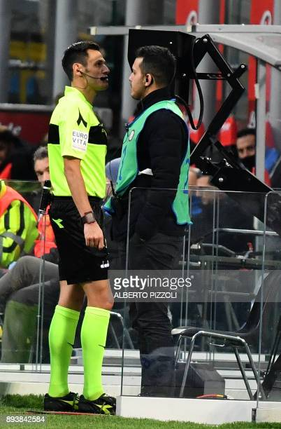 Italian referee Maurizio Mariani consults the video assistant referee before deciding the penalty during the Italian Serie A football match Inter...