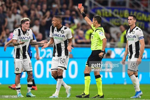 Italian referee Maurizio Mariani gives a red card to Udinese's Argentinian forward Rodrigo de Paul during the Italian Serie A football match Inter...