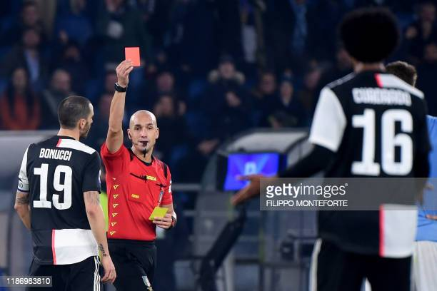 Italian referee Michael Fabbri gives a red card to Juventus' Colombian midfielder Juan Cuadrado during the Italian Serie A football match lazio Rome...