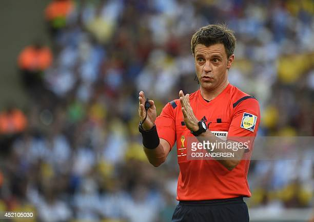 Italian referee Nicola Rizzoli gestures during the 2014 FIFA World Cup final football match between Germany and Argentina at the Maracana Stadium in...