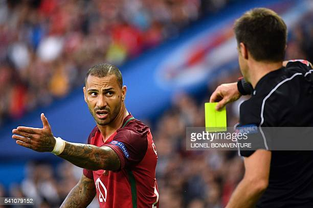 Italian referee Nicola Rizzoli shows the yellow card to Portugal's forward Ricardo Quaresma during the Euro 2016 group F football match between...