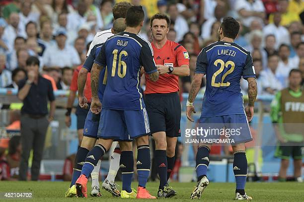 Italian referee Nicola Rizzoli speaks with Argentina's defender Marcos Rojo and Argentina's forward Ezequiel Lavezzi during the 2014 FIFA World Cup...