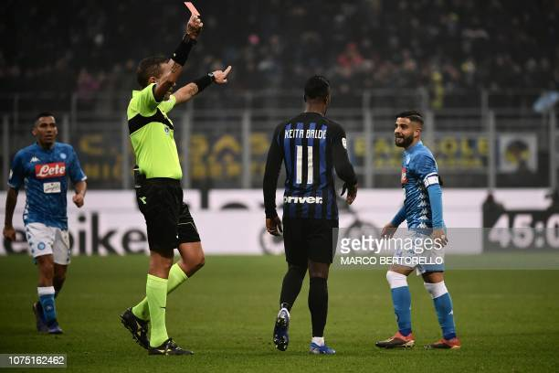 Italian referee Paolo Mazzoleni gives a red card to Napoli's Italian forward Lorenzo Insigne in the last minute of the Italian Serie A football match...