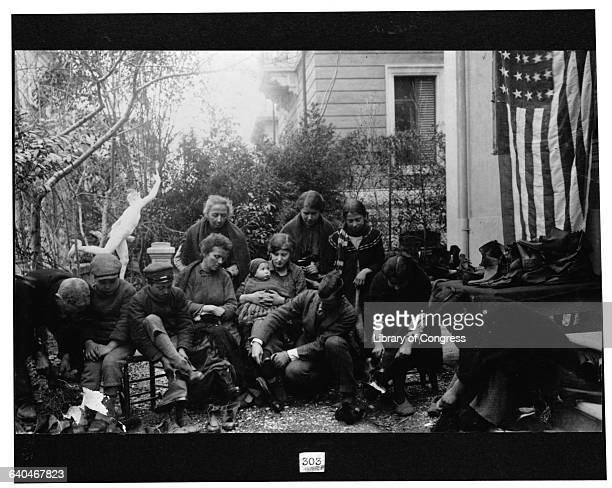 Italian Refugees Receiving Boots from Red Cross