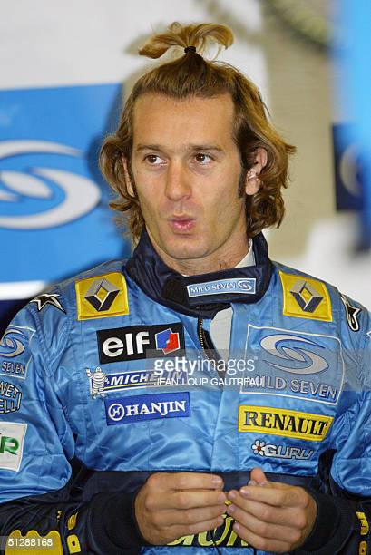 Italian Renault driver Jarno Trulli whistles in the pits of the Monza racetrack during the fourth free practice session on the eve of the Italian...