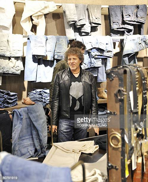Italian Renzo Rosso founder and president of casual fashion brand Diesel inspects his Japanese flagship shop threestory jeans shop at a press preview...