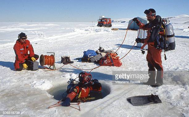 Italian researchers of the Antarctic ice sheet get ready before descending into the waters at a temperature of minus two Celsius, in Antarctica....