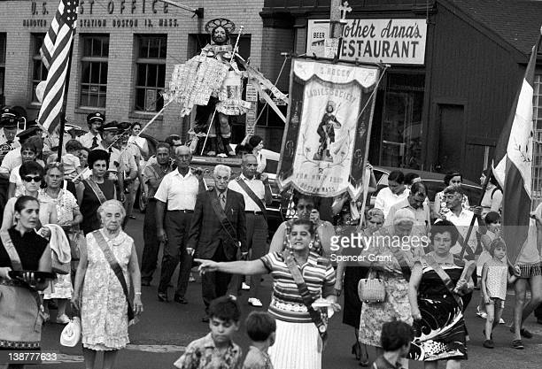 Italian residents of the North End neighborhood attend the annual street festival of Saint Rocco Boston Massachusetts 1970
