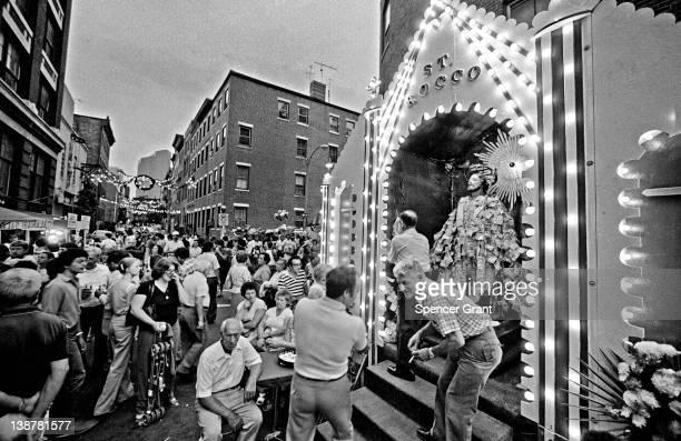 Italian residents of the North End neighborhood attend the annual street festival of Saint Rocco Boston Massachusetts 1976