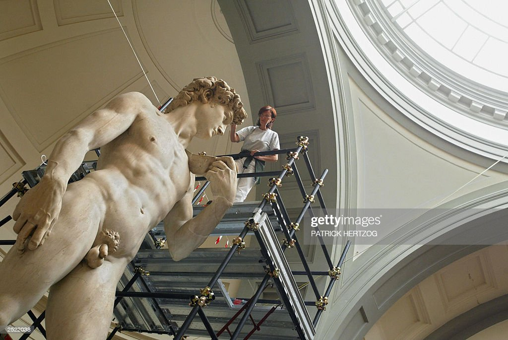 Italian restorer Cinzia Parnigoni works on cleaning one of the world's most famous statues in the world, Michelangelo's David, 15 September 2003 at the Galleria del'Academia in Florence where the statue has been kept since 1873, amid continuing controversy over the delicate operation among art experts. The proposed cleaning technique has simmered among Italian and foreign experts during the 11 years it took for the statue, standing some 4.5 meters (14 feet) high, to be scientifically assessed. AFP PHOTO / Patrick HERTZOG