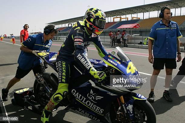 Italian rider and world champion Valentino Rossi of Yamaha starts a free practice session of Qatar Grand Prix World Championships in Doha 29...