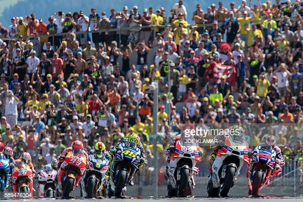 Italian rider Andrea Iannone of Ducati Team leads a pack during the MOTOGP race at the Grand Prix of Austria in Spielberg on August 14 2016 / AFP /...