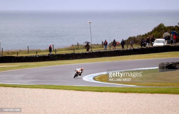 Italian rider Andrea Migno speeds his KTM through a corner during the third Moto3 practice session at the Phillip Island circuit on October 27 ahead...