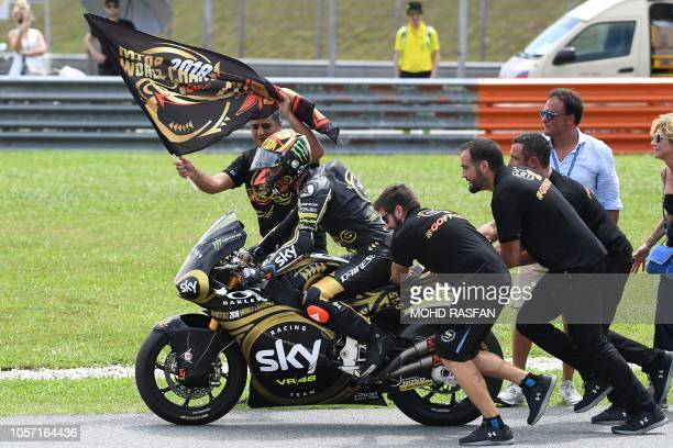 Italian rider Francesco Bagnaia and his team celebrate winning the 2018 Moto2 world championship at the end of the Moto2 race of the Malaysia MotoGP...