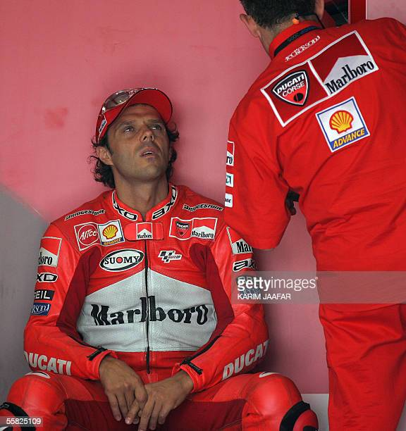 Italian rider Loris Capirossi of Ducati listens to his assistant before a free practice session of Qatar Grand Prix World Championships in Doha 29...