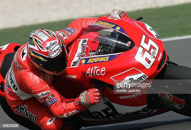 Italian rider Loris Capirossi of Ducati speeds during a free practice session of Qatar Grand Prix World Championships in Doha 29 September 2005 Qatar...