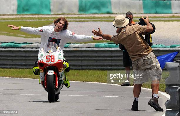 Italian rider Marco Simoncelli of Gilera celebrates at the end of 250 cc Malaysian Grand Prix on October 19 in Sepang Simoncelli on a Gilera won the...