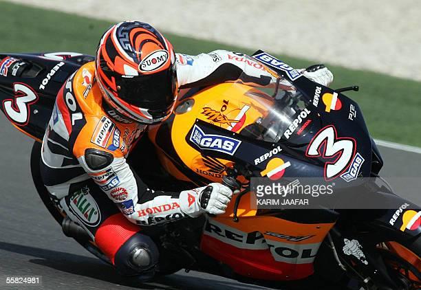 Italian rider Max Biaggi of Honda speeds during a free practice session of Qatar Grand Prix World Championships in Doha 29 September 2005 Qatar Moto...